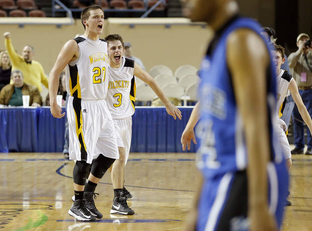 Arnett's Tyler Tune, left, and Trevor Bryant celebrate during the Class B boys state championship game between Coyle and Arnett in the State Fair Arena at State Fair Park in Oklahoma City, Saturday, March 2, 2013. Photo by Bryan Terry, The Oklahoman