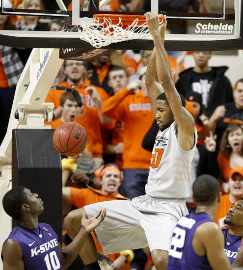 Oklahoma State's Michael Cobbins (20) dunks the ball over Kansas State's Victor Ojeleye (10) during an NCAA college basketball game between the Oklahoma State University Cowboys (OSU) and the Kansas State University Wildcats (KSU) at Gallagher-Iba Arena in Stillwater, Okla., Saturday, Jan. 21, 2012. Photo by Bryan Terry, The Oklahoman