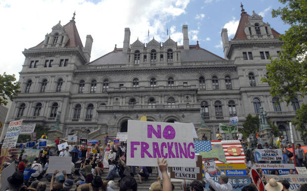 Protesters rally against hyraulic fracturing at the Capitol in Albany, N.Y., on Monday, June 17, 2013.   They are urging Gov. Andrew Cuomo to permanently ban hydraulic fracturing for natural gas in New York, saying it will harm the environment. (AP Photo/Tim Roske)