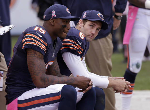 Chicago Bears quarterback Jay Cutler, right, and wide receiver Brandon Marshall sit on the sideline during the second half of an NFL football game against the New Orleans Saints, Sunday, Oct. 6, 2013, in Chicago.(AP Photo/Nam Y. Huh)