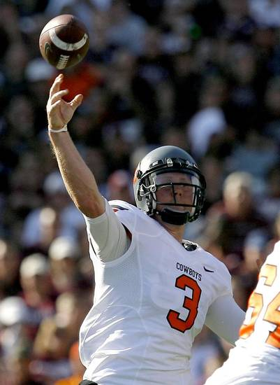 Oklahoma State's Brandon Weeden (3) throws a pass in the second half of the Cowboys' win on Saturday. Photo by Sarah Phipps, The Oklahoman