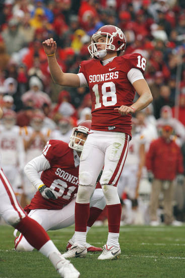 Oklahoma's Michael Hunnicutt (18) watches a kick during a college football game between the University of Oklahoma Sooners (OU) and the Iowa State University Cyclones (ISU) at Gaylord Family-Oklahoma Memorial Stadium in Norman, Okla., Saturday, Nov. 26, 2011. Photo by Steve Sinsey, The Oklahoman