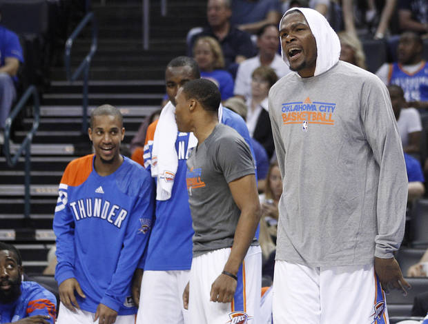 Oklahoma City Thunder forward Kevin Durant, right, reacts to a basket in the fourth quarter of a preseason NBA basketball game against the Charlotte Bobcats in Oklahoma City, Tuesday, Oct. 16, 2012. The Thunder won 120-98. (AP Photo/Sue Ogrocki) ORG XMIT: OKSO112