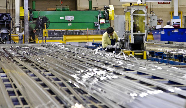 A crew member works with extruded aluminum at the MD Building Products plant on Wednesday, Jan. 2, 2013, in Oklahoma City, Okla. Photo by Chris Landsberger, The Oklahoman