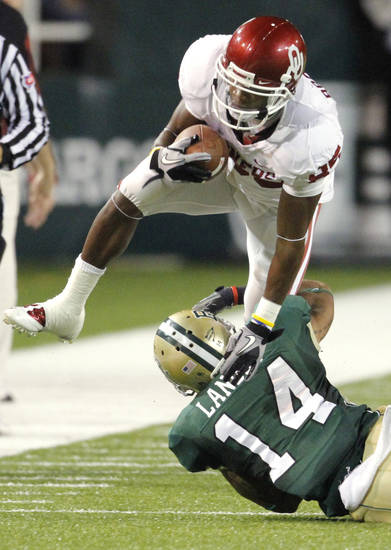 Ryan Broyles (85) gets extra yards after a catch during the first half of the college football game between the University of Oklahoma Sooners (OU) and the Baylor Bears (BU) at Floyd Casey Stadium on Saturday, November 20, 2010, in Waco, Texas.   Photo by Steve Sisney, The Oklahoman