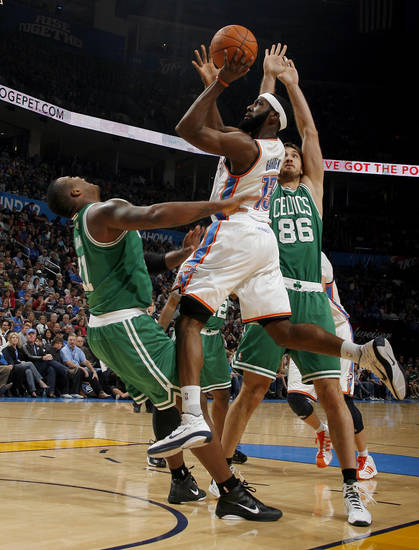 Oklahoma City&#039;s James Harden (13) shoots in between Boston&#039;s Glen Davis  (11) and Semih Erden (86) during the NBA game between the Oklahoma City Thunder and the Boston Celtics, Sunday, Nov. 7, 2010, at the Oklahoma City Arena. Photo by Sarah Phipps, The Oklahoman 