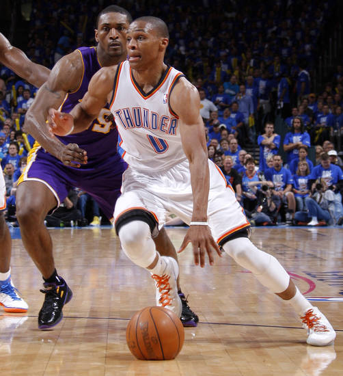 Oklahoma City's Russell Westbrook (0) droves past Los Angeles' Metta World Peace (15) during Game 1 in the second round of the NBA playoffs between the Oklahoma City Thunder and L.A. Lakers at Chesapeake Energy Arena in Oklahoma City, Monday, May 14, 2012. Photo by Bryan Terry, The Oklahoman
