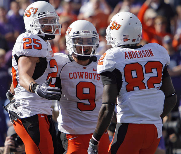 Oklahoma State's Josh Cooper (25), Bo Bowling (9) and Isaiah Anderson (82) celebrate after Cooper's touchdown during the second half of the college football game between the Oklahoma State University Cowboys (OSU) and the Kansas State University Wildcats (KSU) on Saturday, Oct. 30, 2010, in Manhattan, Kan.   Photo by Chris Landsberger, The Oklahoman