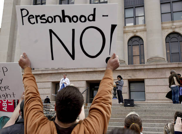 A person holds up a sign speaks during a rally opposing the Personhood measures at the state Capitol, Tuesday, Feb. 28, 2012. Photo by Sarah Phipps, The Oklahoman