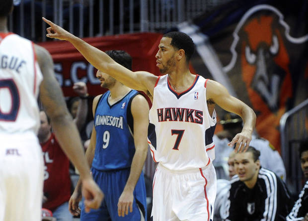 Atlanta Hawks guard Jannero Pargo reacts after scoring against the Minnesota Timberwolves during the final minutes of an NBA basketball game in Atlanta, Monday, Jan. 21, 2013. Atlanta won 104-96. (AP Photo/John Amis)