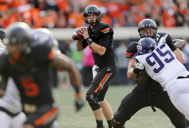 Oklahoma State's Wes Lunt (11) looks to pass during a college football game between Oklahoma State University (OSU) and Texas Christian University (TCU) at Boone Pickens Stadium in Stillwater, Okla., Saturday, Oct. 27, 2012. OSU won, 36-14. Photo by Nate Billings, The Oklahoman