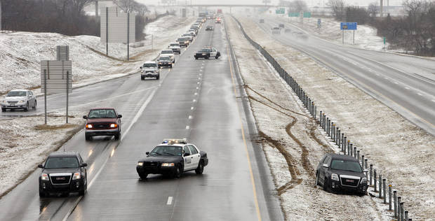Traffic is backed up and motorists drive on the shoulder as Oklahoma City police block the southbound lanes of I-44 at SW 134 Street for a series of accidents on the highway in Oklahoma City Tuesday, Feb. 12, 2013. Photo by Paul B. Southerland, The Oklahoman