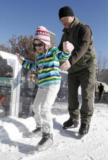John Hubert helps his seven-year-old daughter Isabel learn to skate at the Devon Ice Rink at Myriad Botanical Gardens in Oklahoma City, OK, Saturday, December 29, 2012, By Paul Hellstern, The Oklahoman Archives