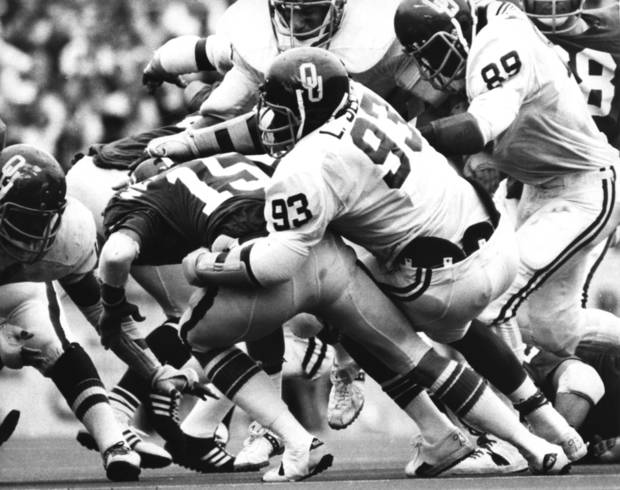 OU defensive lineman Lee Roy Selmon (93) sacks Oklahoma State University quarterback Charlie Weatherbie during the OU-OSU Bedlam football game in Stillwater, Okla., on Nov. 1, 1975.  OU beat OSU that Saturday by a score of 27-7. Staff photo by J. Pat Carter