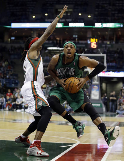 Boston Celtics' Paul Pierce, right, tries to drive past Milwaukee Bucks' Marquis Daniels during the first half of an NBA basketball game on Saturday, Dec. 1, 2012, in Milwaukee. (AP Photo/Morry Gash)