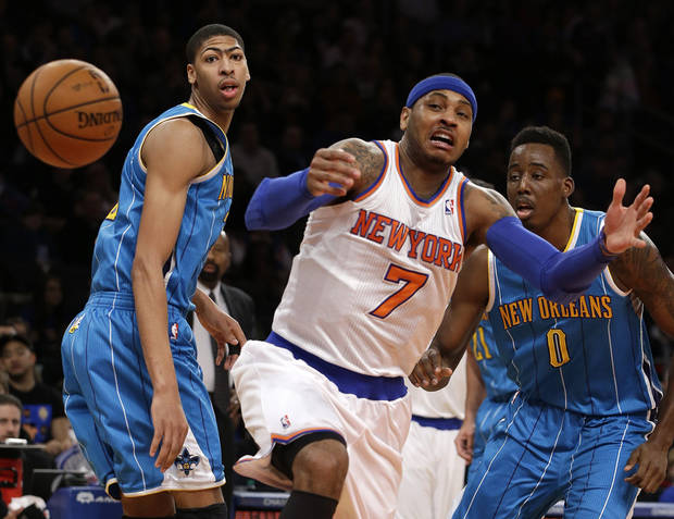 New Orleans Hornets forward Anthony Davis, left, watches as New York Knicks forward Carmelo Anthony (7) loses the ball in the first half of their NBA basketball game at Madison Square Garden in New York, Sunday, Jan. 13, 2013. Hornets forward Al-Farouq Aminu (0) looks on. (AP Photo/Kathy Willens)