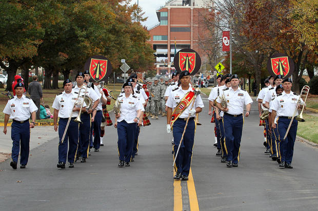 A military band marches down Jenkins Avenue during the Veterans Day parade in Norman Sunday. PHOTO BY HUGH SCOTT FOR THE OKLAHOMAN ORG XMIT: KOD