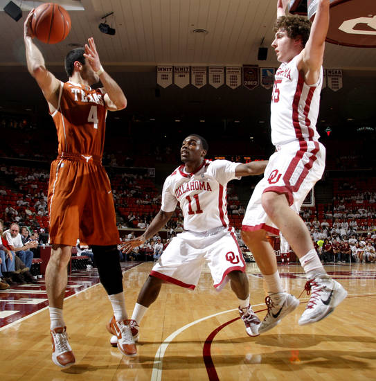 Oklahoma's Calvin Newell Jr. (11) and Tyler Neal (15) defend Texas' Dogus Balbay during the NCAA college basketball game between the University of Oklahoma Sooners and Texas Longhorns at Lloyd Noble Center in Norman, Okla., Wednesday, Feb. 9, 2011. Photo by Bryan Terry, The Oklahoman