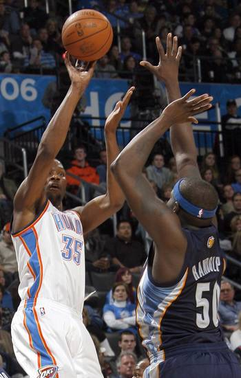 Oklahoma City's Kevin Durant (35) shoots over Memphis' Zach Randolph (50) during the NBA basketball game between the Oklahoma City Thunder and the Memphis Grizzlies, Saturday, Jan. 8, 2011, at the Oklahoma City Arena. Photo by Sarah Phipps, The Oklahoman