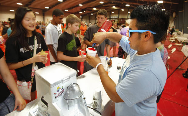 Eskimo Snow owner Adrian Buendia makes snow cones for the crowd at last year�s Taste of Norman event.  THE OKLAHOMAN ARCHIVES