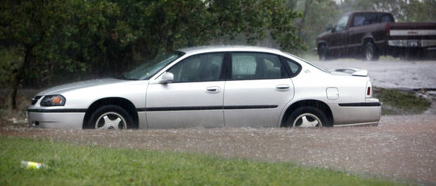 A car stalled out in high water southbound on Classen just north of Wilshire Blvd. during heavy rains in Oklahoma City Monday, June 14, 2010. Photo by Paul B. Southerland, The Oklahoman