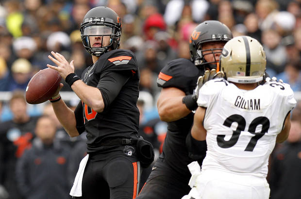 Oklahoma State&#039;s Clint Chelf (10) drops back to pass during the Heart of Dallas Bowl football game between Oklahoma State University and Purdue University at the Cotton Bowl in Dallas, Tuesday, Jan. 1, 2013. Oklahoma State won 58-14. Photo by Bryan Terry, The Oklahoman