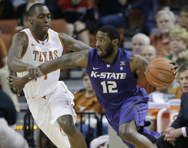 Kansas State's Omari Lawrence (12) moves the ball past Texas defender Sheldon McClellan, left, during the first half on an NCAA college basketball game, Saturday, Feb. 23, 2013, in Austin, Texas. (AP Photo/Eric Gay)
