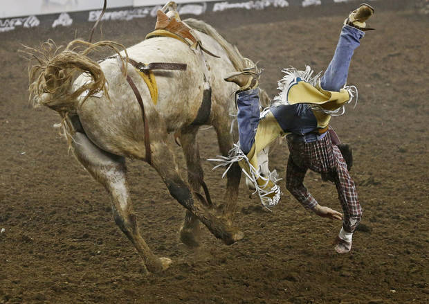 Tim Kent of Greencastle, Pa., falls off during the bareback competition in National Circuit Finals Rodeo at the State Fair Arena, Saturday, April 6, 2013. Photo by Bryan Terry, The Oklahoman