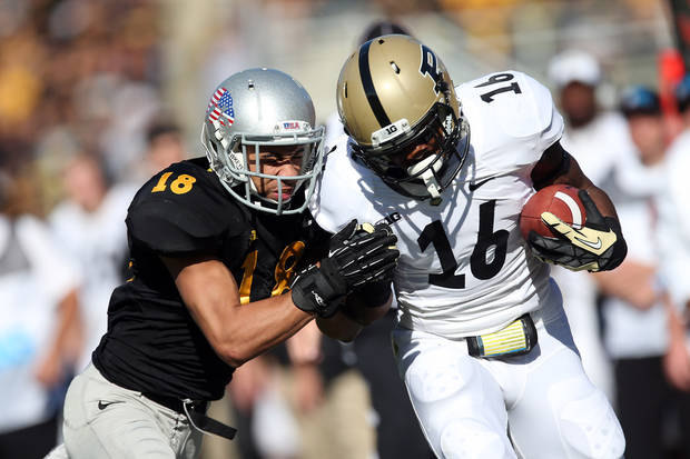 Iowa cornerback Micah Hyde (18) slams into Purdue wide receiver Dolapo Macarthy (16) in the first half of an NCAA college football game, Saturday, Nov. 10, 2012, in Iowa City, Iowa. Purdue won 27-24. (AP Photo/The Gazette, Liz Martin) MAGS OUT
