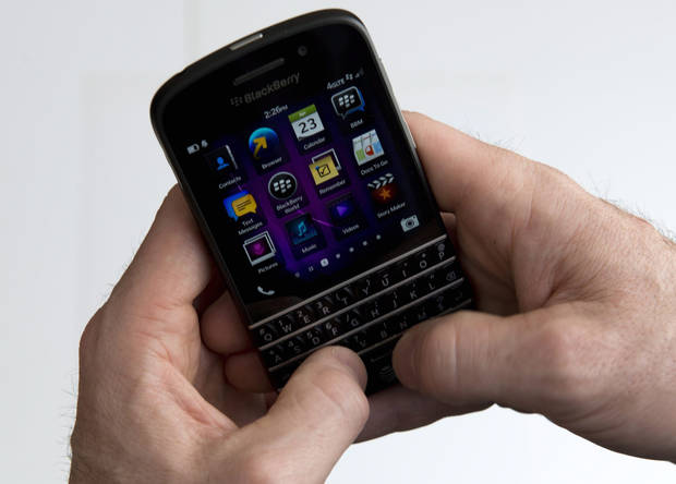 A BlackBerry Q10 smartphone is  displayed in Toronto, Tuesday, April 23, 2013. In the Q10, the keyboard and touchscreen work together. On BlackBerrys, the keyboard has always been about more than filling in text fields, and the new operating system takes that further. (AP Photo/The Canadian Press, Graeme Roy)