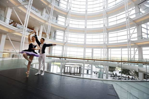 "Oklahoma City Ballet dancers Miki Kawamura and Alvin Tovstogray perform in the rotunda of the Devon Energy Center in Oklahoma City on Thursday. Devon officials announced they are making a $500,000 contribution to completely renovate the OKC Ballet's annual production of ""The Nutcracker."" Photo By Steve Gooch, The Oklahoman"