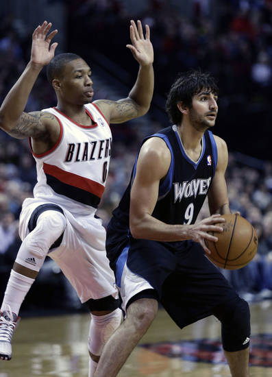 Minnesota Timberwolves guard Ricky Rubio, right, looks to pass as Portland Trail Blazers guard Damian Lillard defends during the first quarter of an NBA basketball game in Portland, Ore., Saturday, March 2, 2013. (AP Photo/Don Ryan)