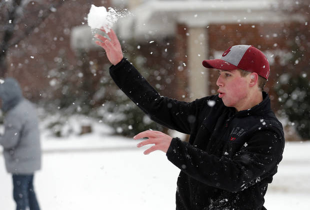 Jeff Russell throws a snowball at the University of Central Oklahoma in Edmond, Okla., Wednesday, Feb. 13, 2013.Photo by Sarah Phipps, The Oklahoman