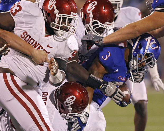 The Oklahoma defense shuts down Kansas' Darrian Miller (3) during the college football game between the University of Oklahoma Sooners (OU) and the University of Kansas Jayhawks (KU) on Saturday, Oct. 15, 2011. in Lawrence, Kan. Photo by Chris Landsberger, The Oklahoman