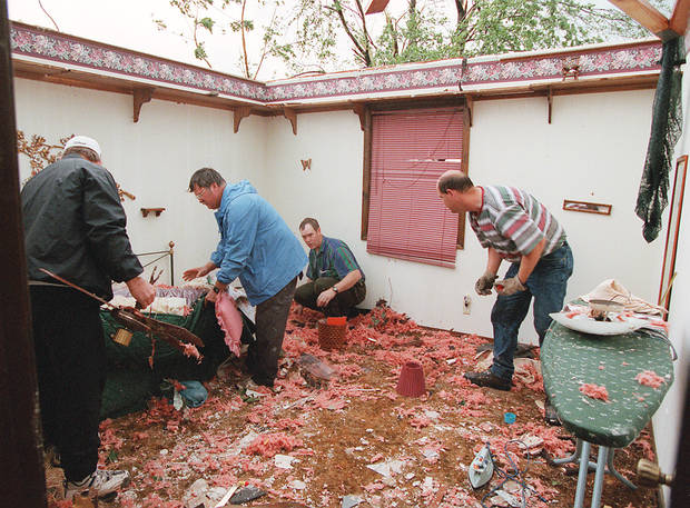 MAY 3, 1999 TORNADO: Tornado damage: Family and friends of Jack and Rhonda Shafer of Mulhall move possessions from the roofless part of the house to an area where some roof remained after the Tornado.