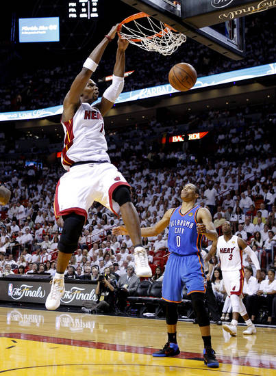 Miami's Chris Bosh (1) dunks the ball beside Oklahoma City's Russell Westbrook (0) during Game 5 of the NBA Finals between the Oklahoma City Thunder and the Miami Heat at American Airlines Arena, Thursday, June 21, 2012. Photo by Bryan Terry, The Oklahoman