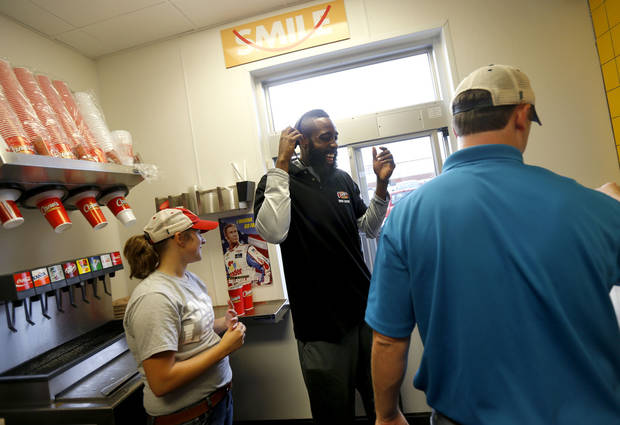 James Harden of the Oklahoma City Thunder laughs as he works the drive-thru lane of the new Raising Cane's in Edmond, Thursday, September 27, 2012. Photo by Bryan Terry, The Oklahoman