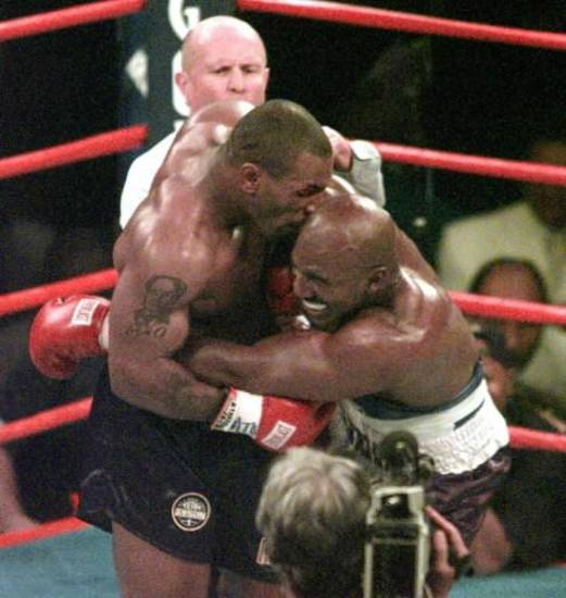 Mike Tyson, left, bit off a part of Evander Holyfield's ear during a boxing match in 1997 at MGM Grand in Las Vegas (AP photo by Jack Smith)