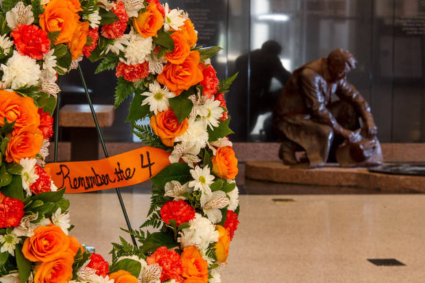 "A wreath stands in the lobby in front of the ""Remember the 10"" memorial dedicated to an earlier crash involving the Oklahoma State University men's basketball team. Saturday is the first anniversary of the airplane crash that killed two Oklahoma State University women's basketball coaches and two OSU supporters. Photo by Mitchell Alcala for The Okahoman <strong>Mitchell Alcala - Mitchell Alcala for the Oklahoma</strong>"