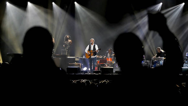 Fans are silhouetted as hey cheer while Eric Clapton performs during his concert at the Chesapeake Energy Arena on Wednesday, March 20, 2013, in Oklahoma City, Okla. Photo by Chris Landsberger, The Oklahoman