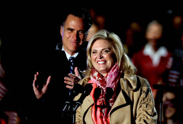 Republican presidential candidate, former Massachusetts Gov. Mitt Romney, left, looks on as wife Ann introduces him at a campaign event at the Comfort Dental Amphitheater, Saturday, Nov. 3, 2012, in Englewood, Colo. (AP Photo/David Goldman)