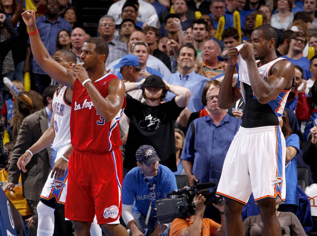 Los Angeles' Chris Paul (3) reacts beside Oklahoma City's Serge Ibaka (9) after winning the NBA basketball game between the Oklahoma City Thunder and the Los Angeles Clippers at Chesapeake Energy Arena in Oklahoma City, Wednesday, April 11, 2012. Oklahoma City lost 100-98.  Photo by Bryan Terry, The Oklahoman