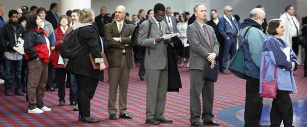 FILE - In this March 7, 2012, file photo shows job seekers standing line during the Career Expo job fair, in Portland, Ore.  Employers pulled back sharply on hiring last month, a reminder that the U.S. economy may not be growing fast enough to sustain robust job growth. The unemployment rate dipped, but mostly because more Americans stopped looking for work.  The Labor Department says the economy added 120,000 jobs in March, down from more than 200,000 in each of the previous three months. (AP Photo/Rick Bowmer) ORG XMIT: NY113