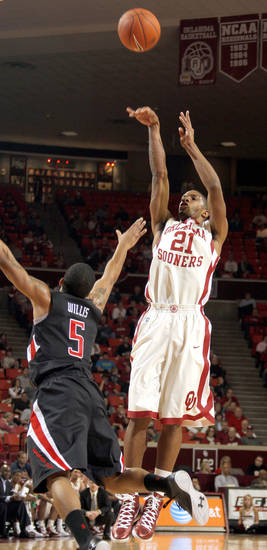 Cameron Clark (21) shoots over Texas Tech's Javarez Willis (5) during the men's college basketball game between the University of Oklahoma  and Texas Tech University of at the Lloyd Nobel Center in Norman, Okla., Tuesday, Jan. 17, 2012. Photo by Sarah Phipps, The Oklahoman