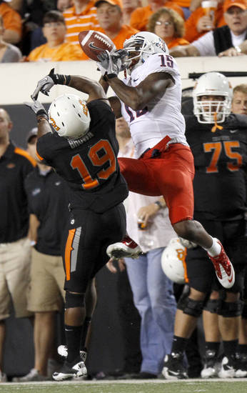 Oklahoma State's Brodrick Brown breaks up a pass intended for Arizona's Dan Buckner on Thursday. PHOTO BY BRYAN TERRY, The Oklahoman