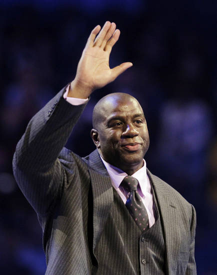 "Hall of Famer Earvin ""Magic"" Johnson waves as he is introduced before the start of the NBA All-Star basketball game, Sunday, Feb. 26, 2012, in Orlando, Fla. (AP Photo/Chris O'Meara) ORG XMIT: DOA128"