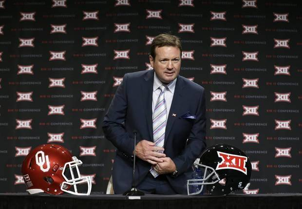 Bob Stoops takes a seat on the main stage of Big 12 Media Days on Tuesday in Dallas. (AP Photo)