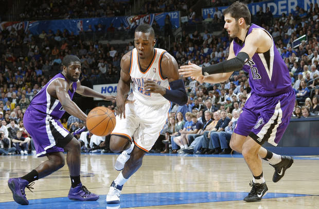 The Thunder's Jeff Green (22) drives the ball past the Kings' Eugene Jeter (5) and Omri Casspi (18) during the NBA basketball game between the Oklahoma City Thunder and The Sacramento Kings on Tuesday, Feb. 15, 2011, Oklahoma City Okla.  Photo by Chris Landsberger, The Oklahoman