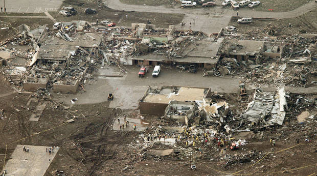 This aerial photo shows damage to the Plaza Towers Elementary School after massive tornado hit Moore, Okla., Monday May 20, 2013. (AP Photo/Steve Gooch) ORG XMIT: OKSG103