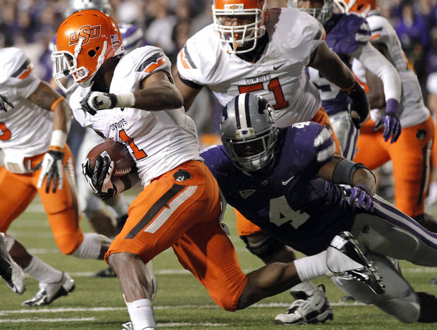 Oklahoma State's Joseph Randle (1) runs past Kansas State's Arthur Brown (4) during the college football game between the Oklahoma State University Cowboys (OSU) and the Kansas State University Wildcats (KSU) at Bill Snyder Family Football Stadium on Saturday, Nov. 1, 2012, in Manhattan, Kan. Photo by Chris Landsberger, The Oklahoman